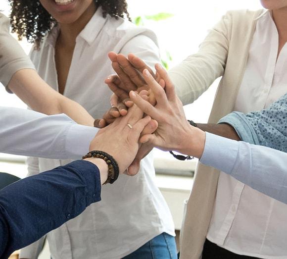 Team members give high five